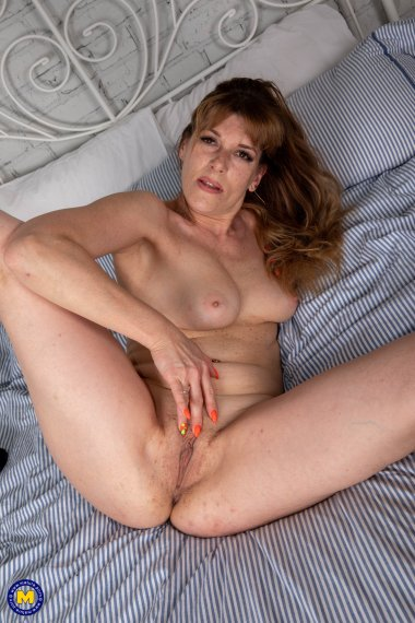 Naughty mom playing with her wet shaved pussy