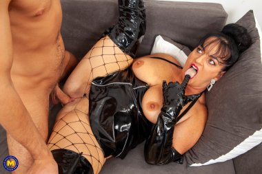 This curvy and Kinky mature slut dominates a toyboy on her couch