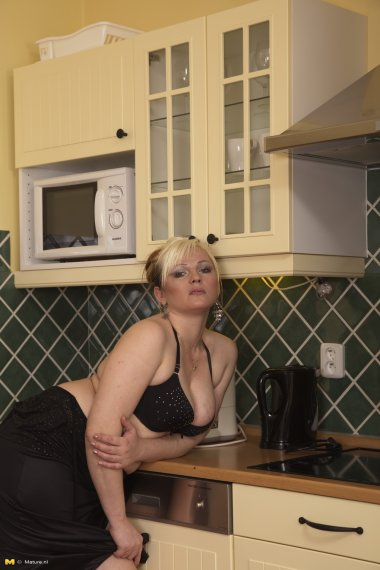 This housewife gets naughty in the kitchen