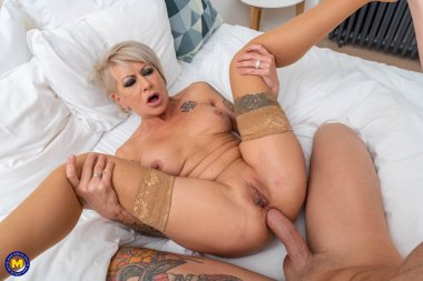 This horny MILF loves getting fucked in the ass by her younger neighbor
