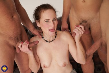 During a photoshoot she gets fucked by three horny guys