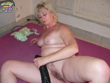 Blonde mature getting busy with huge toys
